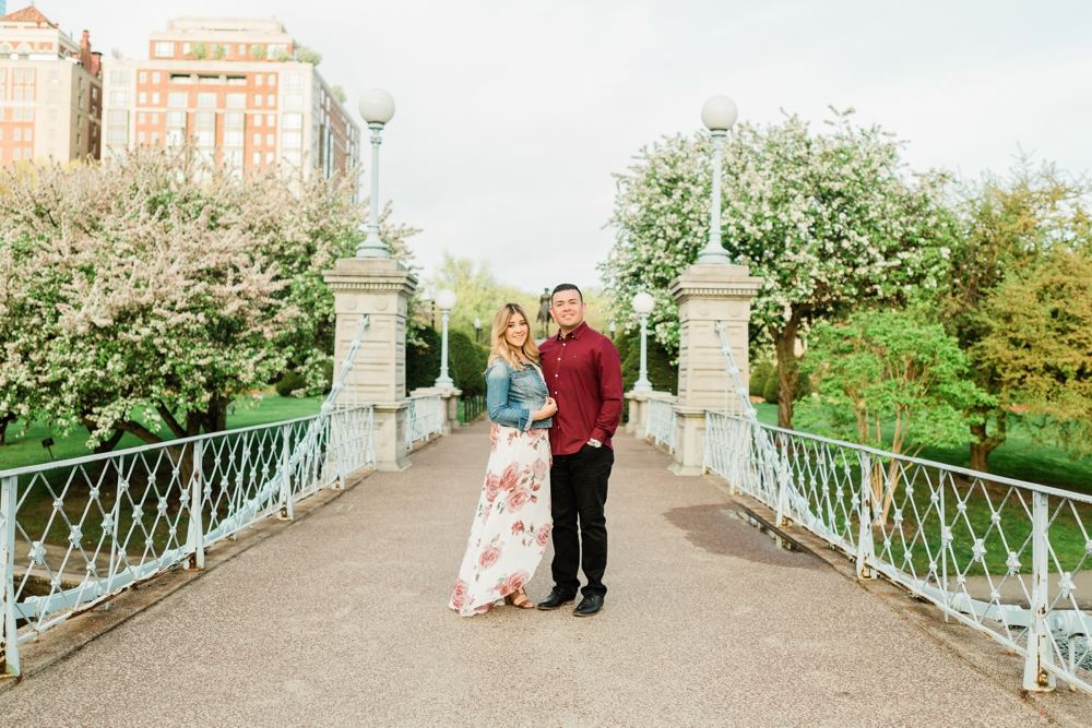 engaged couple on a bridge in boston commons