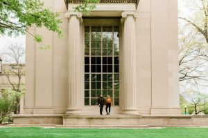 engaged couple standing in front of MIT, MIT engagement session