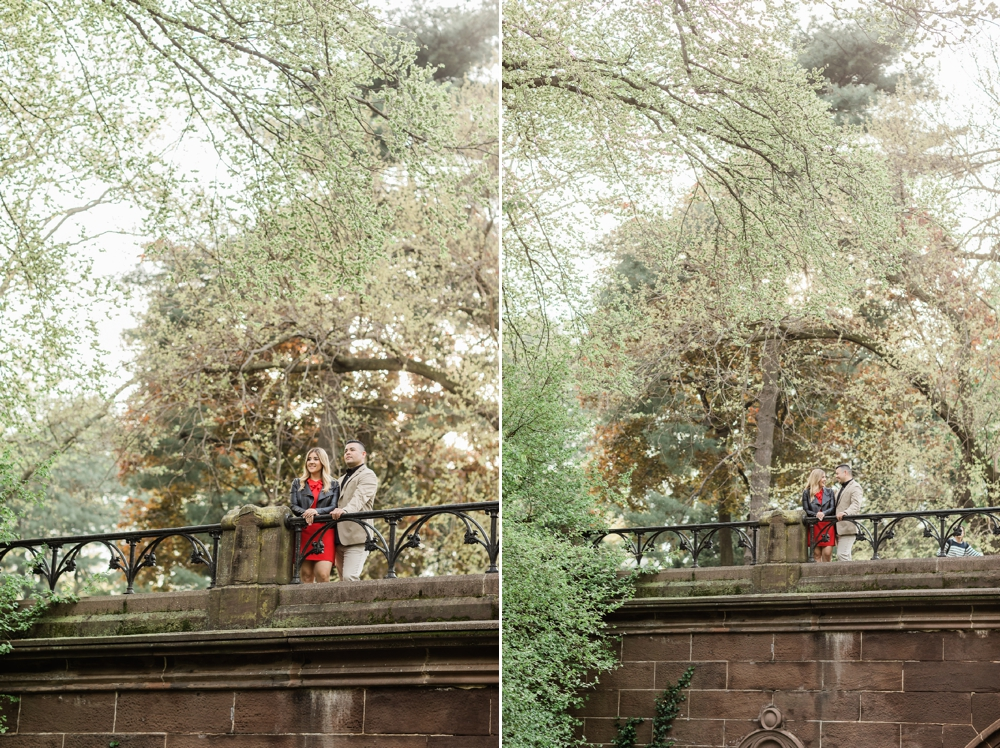 engaged couple standing on trefoil arch central park new york city