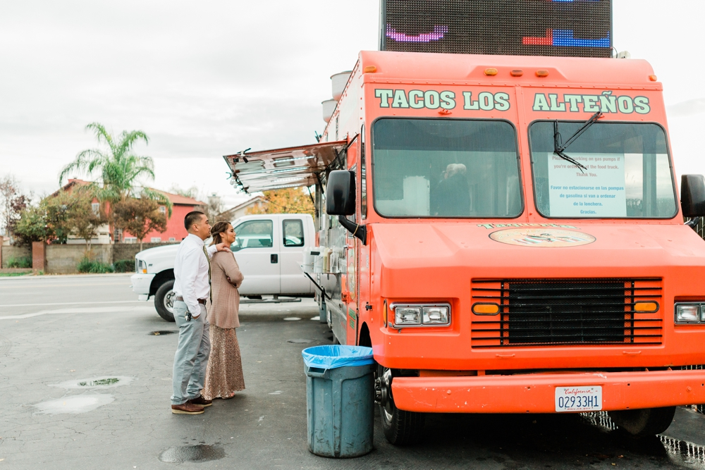 just married couple ordering tacos from a taco truck