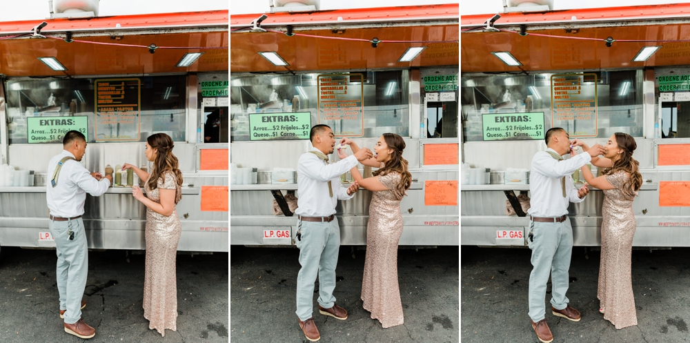 just married couple eating tacos from a taco truck
