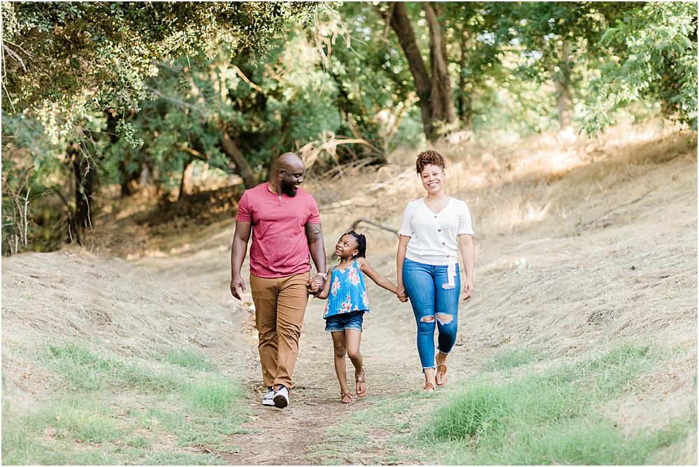 blended family walking in park, family engagement session